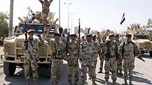 Irakische Soldaten freuen sich über ihre neue Beschützerrolle.
