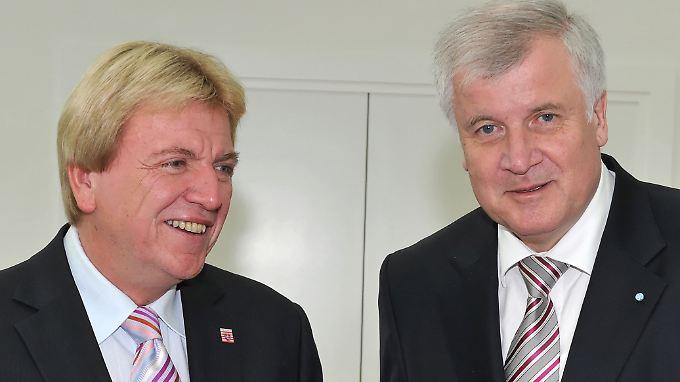 Die Ministerpräsidenten von Hessen und Bayern, Volker Bouffier (l.) und Horst Seehofer.