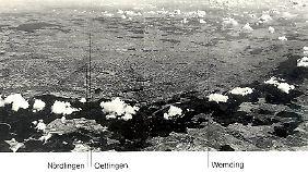 """Das """"Nördlinger Ries"""" ist der besterforschte Meteoritenkrater. Sein Durchmesser: 25 Kilometer. Der Wolkenkranz markiert den bewaldeten Kraterrand."""