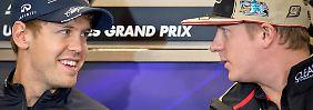 Schau mir in die Augen, Kleiner: Kimi Räikkönen, rechts, und Sebastian Vettel.