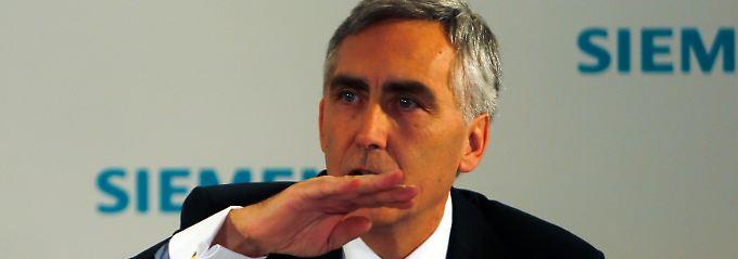 Keine leichte Woche für Peter Löscher: Die schwache Konjunktur schlägt in der Siemens-Bilanz durch. Möglicherweise muss Löscher die Ziele deckeln.