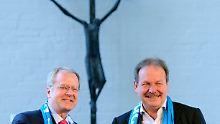 Kirchentagspräsident Robbers und Verdi-Chef Bsirske.
