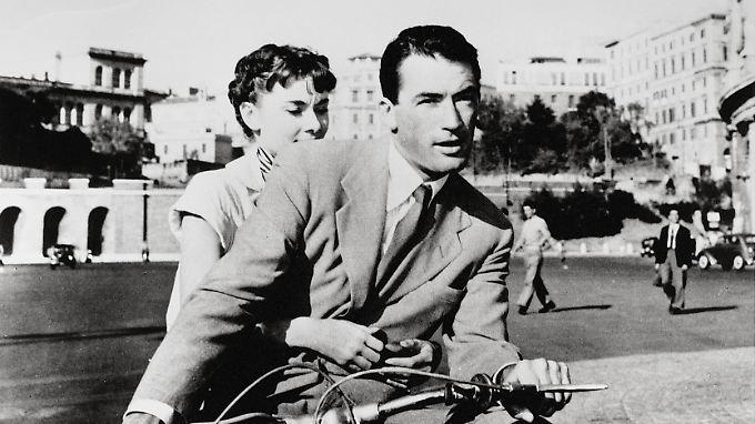 """Audrey Hepburn und Gregory Peck in """"Ein Herz und eine Krone""""."""