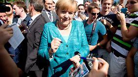 Kochtopf und Kartoffelhacke: Merkel setzt im Wahlkampf auf Bürgernähe