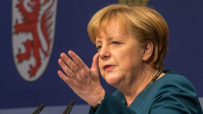 """""""Denn wir wollen regieren"""" - Merkel verteidigt Kompromisse."""