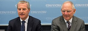 Deutsche-Bank-Co-Chef Jürgen Fitschen (li.) und Finanzminister Wolfgang Schäuble: Offener Schlagabtausch über Bankenregulierung.