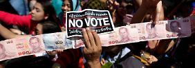 Mehrere Verletzte vor Parlamentswahl: Bei Unruhen in Bangkok fallen Schüsse