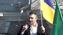 Klitschko setzte seine Rede unbeeindruckt von den Störern fort.