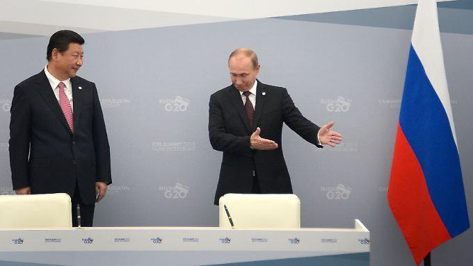 """""""Bittesehr, nach Ihnen"""": Der Sieger im Krim-Konflikt heißt wahrscheinlich nicht Russland oder EU und USA - sondern China."""