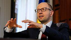 Der ukrainische Regierungschef Arseni Jazenjuk spricht von einem politischen Preis.
