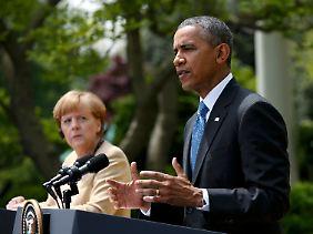 Merkel und Obama bei ihrer Pressekonferenz im Rosengarten des Weißen Hauses.