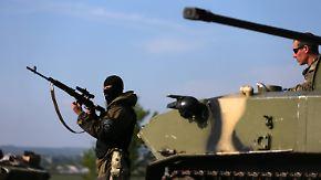 Auf dem Weg zum Bürgerkrieg: Truppen aus Kiew und Separatisten beschießen sich