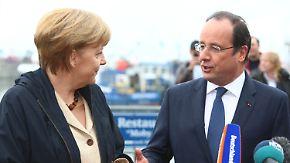 Empfang auf Rügen: Merkel und Hollande sprechen über Europa