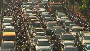 Trampen via App: Junge Indonesier teilen ihre Autos