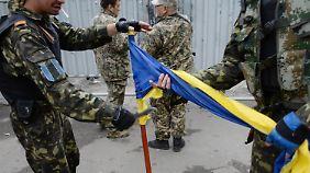 EU droht mit weiteren Sanktionen: Poroschenko verlängert Waffenruhe in der Ostukraine