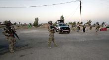 Irakische Soldaten in Saddam Husseins Heimatort Audscha.