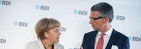 Nicht nur nette Worte: Ulrich Grillo mit Angela Merkel.