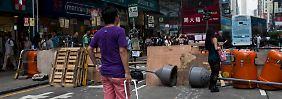 London fordert friedliche Lösung: Hongkonger fürchten gewaltsame Räumung
