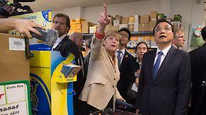 Merkel nimmt Li auf Einkaufstour: Deutschland und China intensivieren Zusammenarbeit