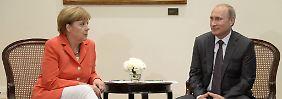 Merkel und Putin im Juli in Rio de Janeiro.