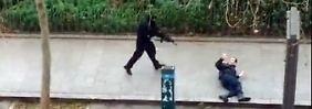 """Anschlag auf """"Charlie Hebdo"""": Täter ermorden Polizisten auf der Straße per Kopfschuss"""