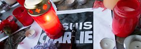 Trauer vor der französischen Botschaft am Pariser Platz in Berlin.