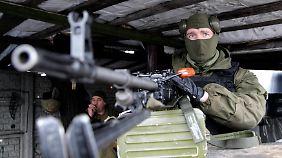 Separatisten kündigen Offensive an: Merkel schlägt Russland gemeinsame Handelszone vor
