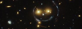 Einsteins Theorie wieder bestätigt: Forscher entdecken Smiley im All