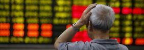 Ausländer hinter Verlusten vermutet: Chinas Börse setzt steile Talfahrt fort