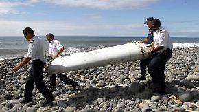 Auch Koffer angeschwemmt: Experten untersuchen mögliches MH370-Wrackteil