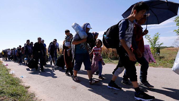 Flüchtlinge an der serbisch-kroatischen Grenze.