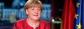 Mahnungen zu Neujahr: Merkel: Lasst euch nicht spalten!