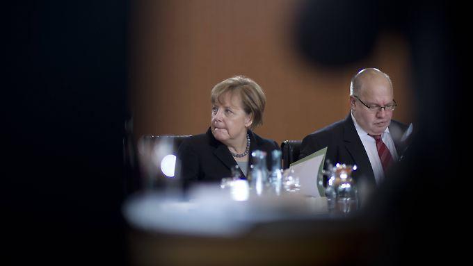 Angela Merkel und ihr Flüchtlingskoordinator Peter Altmaier.