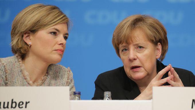 Julia Klöckner und Angela Merkel haben jeweils eigene Ideen zur Flüchtlingspolitik.