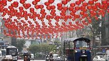 Chinesen feiern Neujahrsfest: Der Feuer-Affe springt auf den Thron