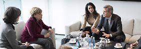 Engagement für Flüchtlinge: George Clooney stattet Angela Merkel einen Besuch ab