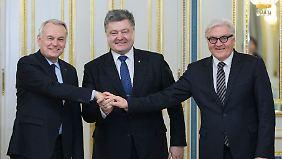 Auch mit Poroschenko trafen sich Ayrault und Steinmeier.