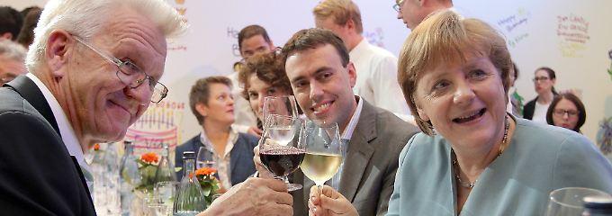 Kretschmann und Merkel verstehen sich gut. Zu gut? Dieses Bild entstand 2012 beim Sommerfest des Landes Baden-Württemberg in Berlin.