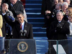 Bei der Amtseinführung von Barack Obama: George W. Bush übergibt seinem Nachfolger viele Probleme.