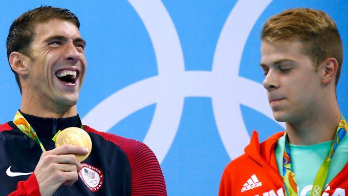 Das ist Olympia-Gold Nummer 20 für Phelps ((l.).