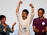 Aktivisten ziehen ins Parlament ein: China-Kritiker triumphieren in Hongkong