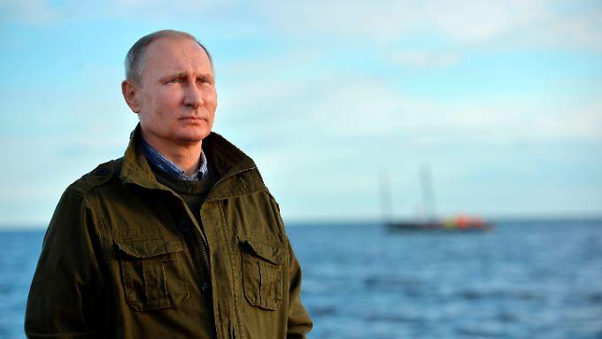 Putin im Bilde: Der einsame Herrscher, der über Russland wacht.