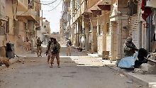 Regierungssoldaten in den Straßen von Palmyra (Archivbild).