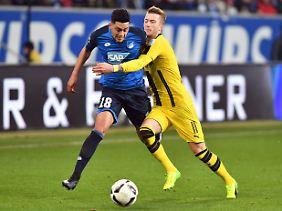 In der Kontaktsportart Fußball üblich: Nadiem Amiri und Marco Reus.