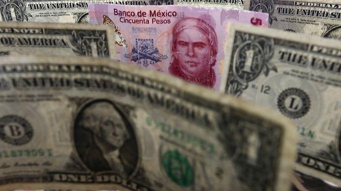 Landeswährung unter Druck: Wenn Donald Trump auch nur einen Teil seiner Drohungen umsetzt, sieht die mexikanische Wirtschaft harten Zeiten entgegen.