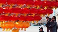 Millionen Chinesen feiern tagelang Neujahr: Ab jetzt regiert der Feuer-Hahn