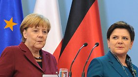German Chancellor Angela Merkel, left, and Poland's Prime Minister Beata Szydlo arrive for a press conference in Warsaw, Poland, Tuesday, Feb. 7, 2017. Merkel came to Poland for talks on Europe's future amid several crisis including Britain's decision to leave the EU. (AP Photo/Alik Keplicz)
