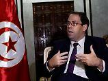 Tunesiens Ministerpräsident Youssef Chahed will den Anschlagsort in Berlin besuchen.