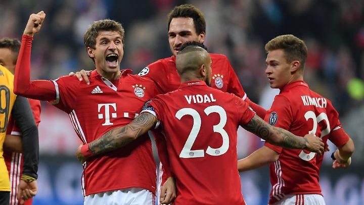 Bajuwarische Glückseligkeit: Thomas Müller und seine Kollegen bejubeln das 5:1 gegen den FC Arsenal.