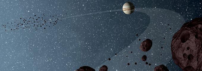 Diese Illustration zeigt die Trojanischen Asteroiden, die die Sonne auf der gleichen Bahn wie der Jupiter umkreisen. Der Geisterfahrer-Asteroid fliegt ihnen entgegen - ohne Kollision.